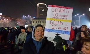 AFP: Pasul înapoi al Guvernului nu calmează furia în România
